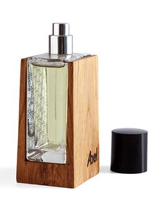 Glass and wood perfume packaging on Vintage '13 fragrance. Wooden casing is handcrafted from reclaimed oak. #packagingdesign #woodpackaging organic perfume #organicperfume