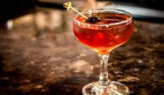 The Manhattan Cocktail Recipe: whiskey, vermouth, bitters and one orange peel or maraschino cherry.