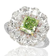 Colored Ring 1 - Ring with Fancy Vivid Yellowish Green Radiant diamond center with surrounding white pear brilliant diamonds accented with fancy pink and white diamond melee in 18kt white and rose gold.