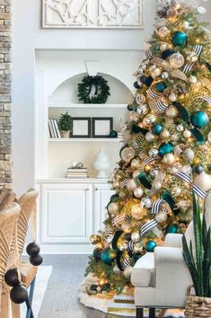 christmas tree ideas teal Christmas Home Tour 2018 - gorgeous Christmas tree including aqua ornaments, gold, silver, emerald.