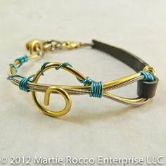 Guitar String wire wrapped bracelet, brass G clef, aqua wire. http://www.artfire.com/ext/shop/product_view/MartieRocco/5576764/guitar_string_wire_wrapped_bracelet_brass_g_clef_aqua_wire_gsb20/handmade/jewelry/bracelets/wire_wrapped#