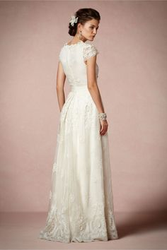 Rococo Gown from BHLDN... Short sleeves and covered back its more modest and sophisticated yet still gorgeous and striking