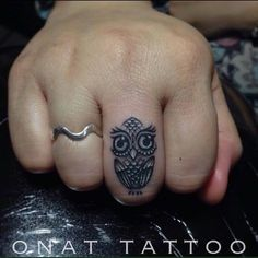 Adorable Small Piece Owl Tattoo On Finger