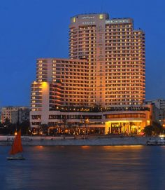 Standing on the site of the historic Semiramis hotel, you can now enjoy modern luxury on the River Nile    Online Travel Agencies, Egypt Tours Packages, Egypt Cairo Holidays Blue sky travel Egypt.