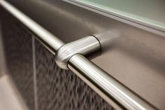 Compass Handrail in Satin Stainless Steel with Bullet standoff shown in LEVELe-105 Elevator Interior with lower panels in Bonded Aluminum with Dark Patina and Waterfall pattern; upper panels in ViviChrome Chromis glass with Mirror Mist interlayer and Opalex finish; handrail panel in Stainless Steel with Sandstone finish Elevator Lobby, Lift Design, Surface Design, Door Handles, Stainless Steel, Detail, Staircases, Door Knobs, Door Knob