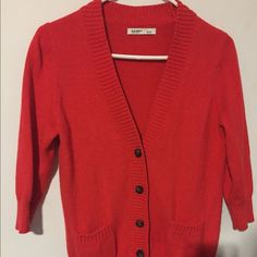 Old Navy red cardigan sweater Cardigan sweater in a red/orange, 3/4 length sleeves and three brown buttons. Very pretty color! Old Navy Sweaters Cardigans