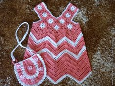 This zig-zag dress has a basic stitch diagram. This work is all about measument. On the top you just need several squares. I don't see much difficulty in making this beauty, there is a nice diagram for the purse.