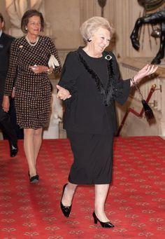 Queen Beatrix of the Netherlands greeting Queen Elizabeth.  Love her expression!