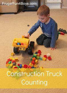Exploring greater than and less than with construction trucks and blocks