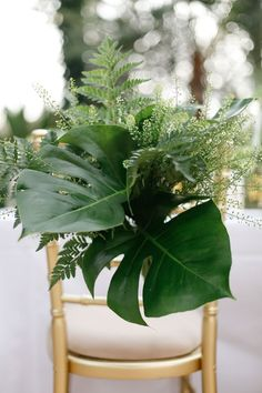foliage chair decor via amy fanton photography / http://www.deerpearlflowers.com/tropical-leaf-greenery-wedding-decor-ideas/