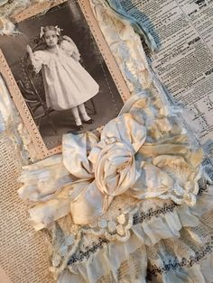 My latest...mixed media collage fashioned from a vintage wedding gown. Vintageflair.typepad.com