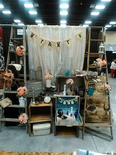 CALL ME AT 801.427.2276 TO RENT THIS OR FOR A FREE CONSULTATION     WOW!  Rustic Ladders, lace strip curtains, and lots of vintage and rustic accessories make a perfect backdrop and display.  I used mason jars, bouquets of flowers, cameras, barn shaped birdcage, metal coffee pots and more to add lots of great details to this display.  This display is normally 12 feet wide, I can also extend it to make it up to 60 ft wide.  PERFECT for hiding an ugly wall at a wedding.