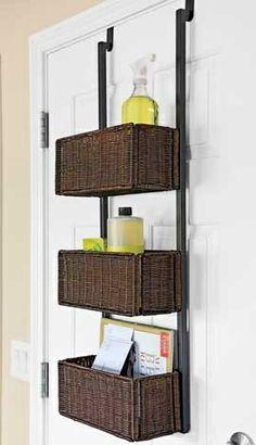 Hanging wicker shelves for bathroom supplies.