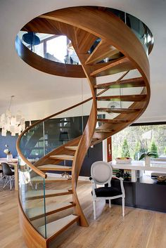 Spiral staircase design light brown tread surface clear glass balustrade metal mid baluster solid wood hand rails wooden tread frame laminate timber flooring rounded b