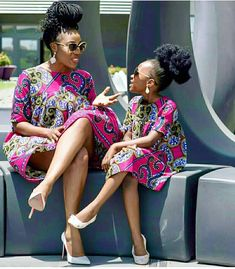 Image may contain: 1 person, sitting African Print Skirt, African Print Fashion, Fashion Couple, Kids Fashion, Mum And Daughter Matching, Nike Roshe, Couples African Outfits, African Lace Styles, African Princess