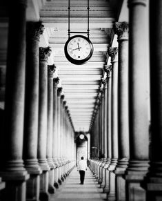 Amazing Pictures of One Point Perspective Photography 10 Hallway, clocks, columns.