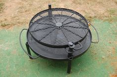 Wagon Wheel BBQ. (etsy) Made of recycled scrap iron including rebar & expanded metal. This piece measure 2.5 feet in diameter and 3 feet high.