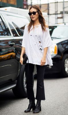 Not crazy about the shirt, but love the flared raw edge cropped jeans with the polished boots...