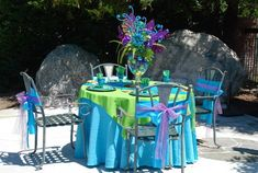 Little Mermaid Birthday Party table setting.  Can also use for an Under the Sea Party.  Love the centerpiece with the clear vase filled with colored Christmas ball ornaments.  Beautiful color combination.