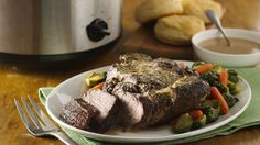 A simple chuck roast slow-cooked with a creamy garlic sauce is sure to please the whole family.