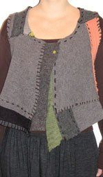 upcycled sweater. Felt sweaters, cut apart to form design, hand stitch together.