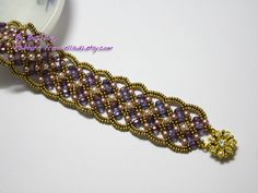 It's Maroon bracelet from Ella's shop. Very easy to make. But in my case, I took lot of time selecting colors for each bead type. lol