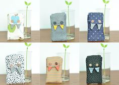 """The world's most adorable """"Munchy Monsters"""" iPhone pouch...makes me wish I had a smartphone."""