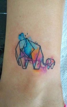Watercolor elephant tattoo by Mando Alducin - love the simplicity with pop of color, but would the geometric design be too much with what I already have? Geometric Elephant Tattoo, Watercolor Elephant Tattoos, Watercolour Tattoos, Tattoo Elephant, Watercolour Tattoo Geometric, Elephant Tattoo Meaning, Colorful Elephant Tattoo, Trendy Tattoos, Tattoos For Women