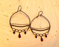 Oxidized sterling silver with beautiful little garnet drops. http://www.calliope-jewelry.com/shades/se81
