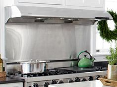HGTV: Caterer Peter Callahan paired a residential Viking range with a commercial-grade Zephyr hood, which has a powerful exhaust fan for heavy-duty cooking.