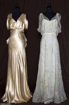 Two 1935 bias-cut silk evening gowns: Both sleeveless, low cut back and low V front neckline: one white chiffon w/stylized delicate floral patterns hand-embroidered in silk floss w/silver beaded stems and abstract elements, ivory crepe underslip, self-fabric sash and one pale gold silk charmeuse bodice w/knotted CF, bias cut, fitted through hip, tulip-shaped skirt, and 2-looped sashes at CB waist. Via Brooklyn Museum.,
