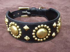 Spotted leather dog collar - hand-stitched - custom made. $190.00, via Etsy.  English bridle leather with solid brass (stainless steel available too).
