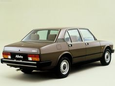 1982 Alfa Romeo Alfetta You'd think, having gone to all the trouble of booking a studio and a professional photographer, and having cleaned the Alfetta to within an inch of its life that they could have done something a little more dynamic with the...