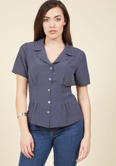 <p>There's nostalgia woven into every detail of this navy blouse from Banned! From its crisp collar and waist-cinching cut to its pearlescent buttons and white-dotted print, this silky number brings you back to bygone times with every thoughtful outfit pairing.</p>