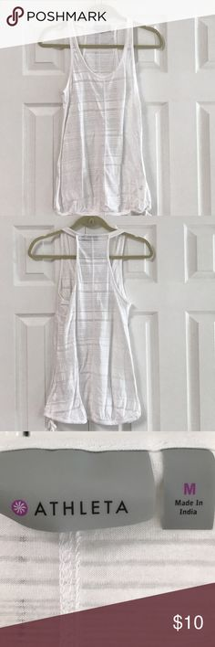 Athleta racerback tank top 53% polyester 47% cotton machine wash cold Color is the pattern of white stripes.  Top has a drawstring at the bottom. Armpit to armpit measures 17 1/2 inches flat. Shoulder to bottom hem is approximately 27 inches. Has been gently washed and worn and has no rips no stains. No trades and please use offer button Athleta Tops Tank Tops