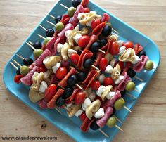 Super easy...I made it with green olives, pepperoni, fresh mozz and tomatoes. Drizzled with olive oil and sprinkled with pepper. Antipasto Skewers #appetizer #summer