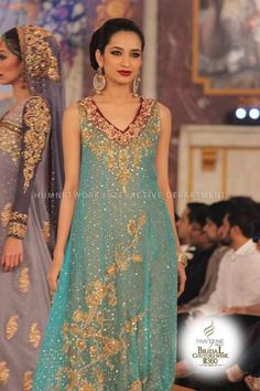 Image from http://www.fashionsuitsme.com/wp-content/uploads/2013/12/Pantene-Bridal-Couture-Week-2013-Day-3-0005.jpg.