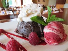 Rich warm Chambord dark chocolate cake with raspberry coulis, vanilla whipped cream and a raspberry-vanilla swirl of sorbet and ice cream. Chocolate Raspberry Cake, Dark Chocolate Cakes, Dessert Chocolate, Vanilla Whipped Cream, Ice Cream, Molten Cake, Raw Bars, Chambord, Wine List