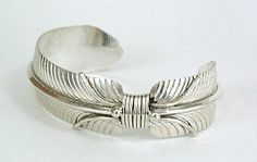 Beautiful sterling silver feather bracelet by Navajo silversmith Milton Vandever.