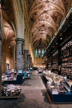 """""""Polare Maastricht, a bookshop housed in a centuries-old Dominican church [in Maastricht, Netherlands] . Dutch design firm Merkx and Girod made dramatic use of the huge space, creating multistory steel shelving."""" """"Truly Novel Bookstores,"""" by Jemima World's Most Beautiful, Beautiful Places, Loire Valley, Beautiful Library, World Pictures, Architecture, Places To See, Amsterdam, Around The Worlds"""
