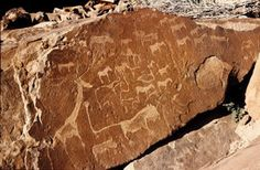 """NAMIBIA. Twyfelfontein or /Ui-//aes. Petroglyphs of rhinoceros, elephants, ostrich, giraffes, humans, footprints. """"The site forms a coherent, extensive, and high-quality record of ritual practices relating to hunter-gatherer communities in this part of southern Africa over at least 2,000 years, and eloquently illustrates the links between the ritual and economic practices of hunter-gatherers."""""""