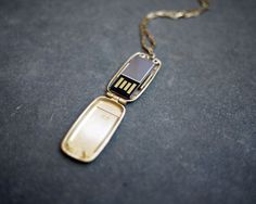 Oh my gosh. I want this. It's a gold locket with USB inside. Perfect!!! $170