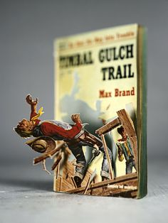 """American photographer Thomas Allen constructs witty and clever dioramas using figures cut from the covers of old pulp paperbacks. Using salacious pulp art drawing's of the and that covered books such as """" I Married a Dead Man"""" and """" Mari. Thomas Allen, Art Thomas, Pop Up Art, Arte Pop Up, Book Art, Book Cover Art, Pulp Fiction, Paper Cutting, 3d Art"""