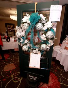 Crystal Blue Persuasion Wreath by Kris Carlson. Door displays donated by Weathertight Leukemia And Lymphoma Society, Door Displays, How To Raise Money, 4th Of July Wreath, Christmas Wreaths, Trees, Crystal, Holiday Decor, Blue