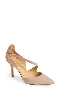 Free shipping and returns on Enzo Angiolini 'Czarlita' Asymmetrical Strap Pointy Toe Pump (Women) at Nordstrom.com. A slender asymmetrical strap, secured by a delicate oval buckle, curves its way around the foot on this sinuous pump that's styled with a chic high topline at the back, a sleek pointy toe and a slim, walkable heel.