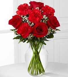 The FTD Sweet Perfection™ Bouquet is an eye-catching way to capture their attention. Rich red roses and carnations are beautifully set amongst baby's breath and lush greens in a classic clear glass vase to create a sweet sentiment of love and affection only at $47.90
