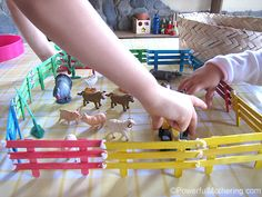 Powerful Mothering - craft stick fences for small world play