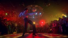 John Travolta disco dancing in an iconic scene from Saturday Night Fever which takes place in Brooklyn. Ricky Martin, Bon Jovi, Look Disco, Disco Disco, Disco Ball, Disco Floor, 1970s Disco, 70s Films, You Should Be Dancing