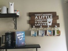 Love Disney and Starbucks? Have some of those amazing Disney mugs around but no way to display them? Well here is a fun solution for that problem. This sign is approx: 10 x 20. Includes 4 hanging hooks for hanging the mugs of your choice. Design is a vinyl decal. Hanging hardware is included on the back. This sign is a dark stain with a white vinyl decal and white hanging hooks for the mugs. This is an original Measurements By Amanda creation. Order now to guarantee availability.  Like the…