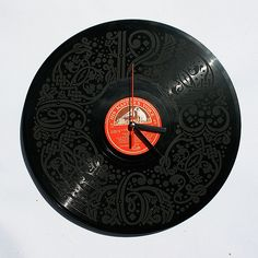 Laser engraved vinyl record clock.